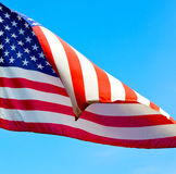 usa waving flag in the blue sky bcolour and wave Royalty Free Stock Images