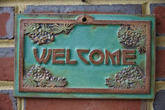 USA. Welcome sign on a brick wall Stock Photography