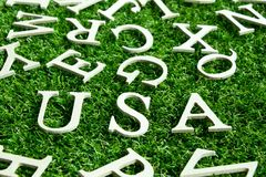 USA wording placed on artificial green grass background. Concept for United States of America Stock Image