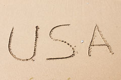 USA, written on a sandy beach Stock Photo