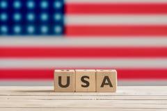 USA-Zeichen gemacht von den hölzernen Würfeln Lizenzfreie Stockfotos