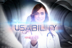 Usability against abstract pattern in grey. The word usability and portrait of female nurse holding out open palm against abstract pattern in grey Royalty Free Stock Images