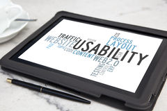 Usability. Tablet with usability software word cloud Royalty Free Stock Images