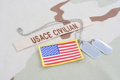USACE CIVILAN branch tape with dog tags  and flag patch on desert camouflage uniform. USACE CIVILAN branch tape with dog tags and flag patch on desert camouflage Royalty Free Stock Photo