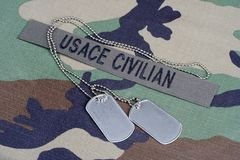 USACE CIVILAN branch tape and dog tags on woodland camouflage uniform. USACE CIVILAN  branch tape and dog tags on woodland camouflage uniform background Royalty Free Stock Images