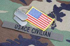 USACE CIVILAN branch tape, flag patch and dog tags on woodland camouflage uniform. USACE CIVILAN  branch tape, flag patch and dog tags on woodland camouflage Stock Photography