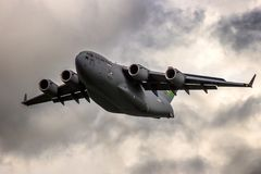 USAF Boeing C-17 Globemaster airplane. LEEUWARDEN, THE NETHERLANDS - MAY 5, 2015: US Air Force Boeing C-17 Globemaster III transport plane taking off from stock image
