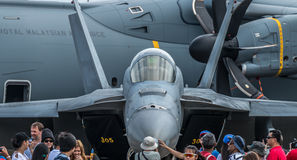 USAF F-15 on hard standing at the Singapore Airshow 2016. An F-15 belonging to the US Air Force surrounded by crowds at the 2016 Singapore Airshow. The airshow royalty free stock images
