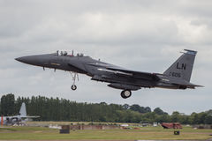USAF F15 Lands at RIAT. RAF FAIRFORD, UK - 7 JULY: A United States Air Force F15 lands at The Royal International Air Tattoo on 7th July 2016 royalty free stock photo