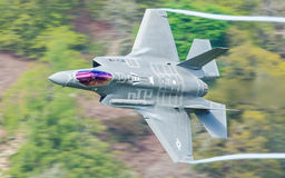 USAF F-35A Lightning II F35. Lockheed Martin USAF F-35A / F35 Lightning II first time low level in the Mach Loop this week 2nd May 2017 Royalty Free Stock Photo