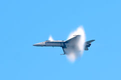 USAF FA-18 Hornet. A condensation dome shrouds a USAF FA-18 Hornet as it accelerates suddenly during an airshow Stock Images
