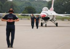 USAF Thunderbird ground team. Members of the USAF Thunderbirds ground team, go through the take off routine prior to performance at Quonset Point in North Royalty Free Stock Photography