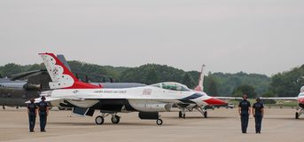 USAF Thunderbird ground team. Members of the USAF Thunderbirds ground team, go through the take off routine prior to performance at Quonset Point in North Royalty Free Stock Photo