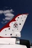USAF Thunderbird Tail with Emblem. This close-up of a USAF Thunderbird tail set against a deep, blue sky showcases the Thunderbird emblem stock photos