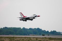 USAF Thunderbird taking off. A member of the USAF Thunderbirds takes off to do a performance at Quonset Point in North Kingstown, Rhode Island royalty free stock photography