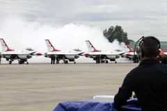 USAF Thunderbirds airshow. SUBANG, MALAYSIA - OCTOBER 3: USAF Thunderbirds lined up after an airshow as a ground crew looks on October 3, 2009 in Subang Royalty Free Stock Photos