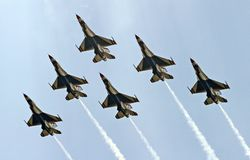 USAF Thunderbirds in a delta formation. Six airforce thunderbirds in a delta formation Stock Photo