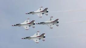 USAF Thunderbirds diamond formation. SUBANG, MALAYSIA - OCTOBER 3: The U.S. Air Force F-16 Thunderbirds fly in diamond formation at the Thunderbirds Airshow in royalty free stock images