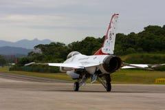 USAF Thunderbirds taxiing down the runway. SUBANG, MALAYSIA - OCTOBER 3: The U.S. Air Force F-16 Thunderbirds taxiing down the runway for take off at the Royalty Free Stock Image