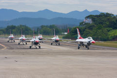 USAF Thunderbirds taxiing down the runway. SUBANG, MALAYSIA - OCTOBER 3: The U.S. Air Force F-16 Thunderbirds taxiing down the runway for take off at the stock images