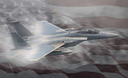 USAF United States Air Force jet. Real in flight F15C / F15 fighter jet of the USAF, United States Air Force.  Over American Stars and Stripes flag Stock Photography
