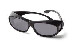 Usage au-dessus des lunettes de soleil Photographie stock libre de droits