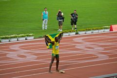 Usain Bolt celebrates with Jamaican flag. Usain Bolt sets new world record  for mens 100-Meter sprint at the 2008 Olympic games in Beijing Royalty Free Stock Photography