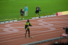 Usain Bolt celebrates victory. Usain Bolt sets new world record  for mens 100-Meter sprint at the 2008 Olympic games in Beijing Royalty Free Stock Photography