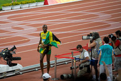 Usain Bolt celebrates victory. Usain Bolt sets new world record  for mens 100-Meter sprint at the 2008 Olympic games in Beijing Royalty Free Stock Photo