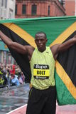 Usain Bolt with flag. Royalty Free Stock Image
