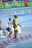 Usain Bolt at 100m start line at Rio2016 Olympics. Usain Bolt, a Jamaican sprinter at 100m starting blocks during Round 1, heat 7 at Olympic Stadium in Rio de Royalty Free Stock Images