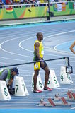 Usain Bolt at 100m start line at Rio2016 Olympics. Usain Bolt, a Jamaican sprinter at 100m starting blocks during Round 1, heat 7 at Olympic Stadium in Rio de Stock Photo
