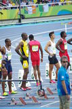 Usain Bolt at 100m start line at Rio2016 Olympics. Usain Bolt, a Jamaican sprinter at 100m starting blocks during Round 1 at Olympic Stadium in Rio de Janeiro Royalty Free Stock Photo