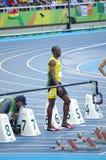 Usain Bolt på den 100m startlinjen på OS:er Rio2016 Arkivfoto