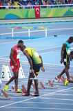 Usain Bolt på den 100m startlinjen på OS:er Rio2016 Arkivfoton