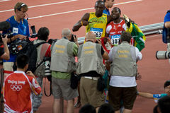 Usain Bolt and Richard Thompson celebrate victory. Usain Bolt sets new world record  for mens 100-Meter sprint at the 2008 Olympic games in Beijing Stock Photos