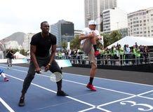 Usain Bolt runs. Rio de Janeiro-Brazil, Usain Bolt runs the 100 meters event during event on Copacabana beach Stock Photo
