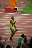 Usain Bolt's victory lap. Usain Bolt sets new world record  for mens 100-Meter sprint at the 2008 Olympic games in Beijing Stock Photos