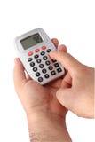 Usando a calculadora Imagens de Stock Royalty Free