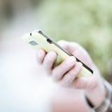 Usando el teléfono celular Fotografía de archivo libre de regalías