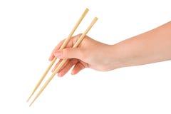 Usando o chopstick Fotos de Stock Royalty Free