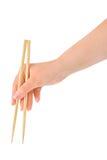 Usando o chopstick Imagem de Stock