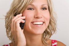 Usando o telefone Imagens de Stock