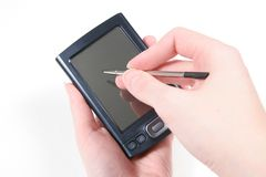 Usando PDA con la penna Fotografie Stock