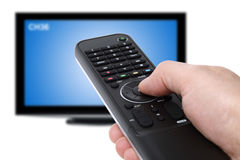 Usando telecomando della TV Fotografia Stock