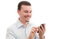 Usando un smartphone Imagen de archivo libre de regalías