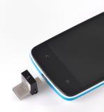 USB闪光驱动3 0和手机 免版税库存图片