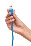 0 3 usb 0缆绳在妇女的手上 免版税库存图片