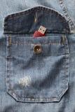 USB在牛仔布衬衣口袋的闪光驱动 免版税库存图片