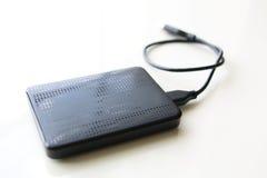 便携式与USB缆绳的外置硬盘驱动 免版税库存照片
